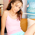 Sweet teen in pink and blue teases as she strips down